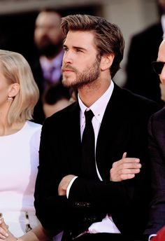 Liam Hemsworth gazing dreamily off into the distance