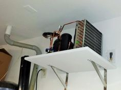 The wine cellar cooling unit condenser is placed in a garage.  This is a split type wine cellar cooling where the evaporator is placed inside the wine cellar or wine cabinet. See more of this wine cabinet project here - https://www.pinterest.com/winecellarsca/manhattan-beach-los-angeles-stunning-wine-rack-cab/.