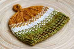 Ravelry: Golden Pear pattern by Melissa Thomson. I know a sweet baby boy in Colorado that needs this!