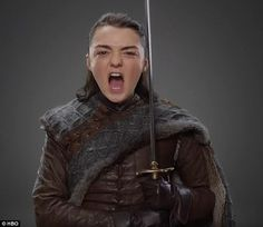 War cry: Maise Williams, 19, who plays Arya Stark, is also dressed in what appears to be combat gear, and holds her sword Needle at attention