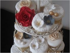 Google Image Result for http://www.wedbits.com/wp-content/uploads/2011/05/vintage-decorated-cupcakes-from-le-beau-cake.jpg