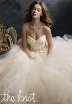 Gown features floral jewel encrusted band at waist.