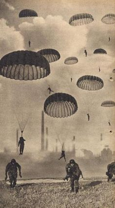 2 World War, German paratrooper, soldiers dropping from the sky landing on the ground. Vintage photo
