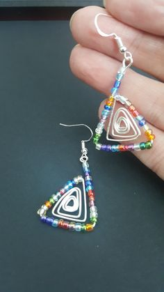 Silver triangle with seed beads found on SoulProjects on Facebook.