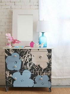 Dress a dresser with a large poster to give a plain piece punch! http://www.bhg.com/decorating/do-it-yourself/accents/easy-weekend-decorating-projects/?socsrc=bhgpin122614artisticfurniture&page=24