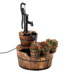 This vintage-inspired fountain and planter trio is an ode to simpler times. The soothing sound of cascading water falls from the well pump into wooden barrel. Old Fashioned Water Pump Barrel Fountain by My Custommade. Fountains For Sale, Garden Fountains, Water Fountains, Outdoor Fountains, Barrel Fountain, Patio Fountain, Fountain Ideas, Fountain Design, Cascade Water