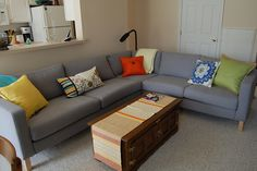Gray Couch with Multicolored Pillows