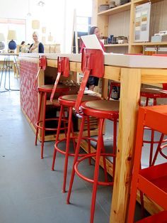 Heath Ceramics painted their National Public Seating stools orange! Just saw them in person today and they're awesome.
