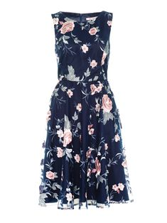 A luxurious dress for special summer outings, the Blue Jasmine Dress captivates with delicate metallic floral embroidery over a Navy base, falling in soft, romantic folds just above the knee. The sleeveless dress has a concealed zipper at the back, and matching trim detail at the crew neck.