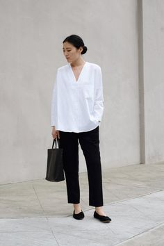 daily uniform in white shirt and black trousers
