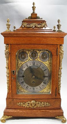 "LARGE FANCY BRACKET CLOCK. Triple fusee, two tunes on nest of 8-bells. 25""h. (Note: running)."