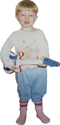 #49 Childhood flashback: When I wasn't a knight I played in a rock band in the kitchen. Notice the road worn guitar!