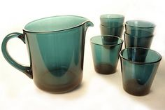 "Kartio glass set,  Kaj Franck,  Nuutajarvi,  Finland 1958. Kartio is Finnish for ""cone."" These six stackable glasses come with their matching pitcher."