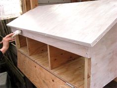 Instructions to add external nesting boxes to your chicken coop. Site offers a great design with easy cleaning features with relatively simple construction.