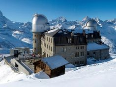 The Most Precariously Perched Hotels, 3100 KULMHOTEL GORNERGRAT Zermatt, Switzerland  At 10,000 feet above sea level, 3100 Kulmhotel Gornergrat is the highest hotel in the Swiss Alps—giving the climbers, skiers, and astronomers who stay here a panoramic view of the surrounding mountains. All guest rooms are named after one of the 29 peaks outside the hotel, and the room number corresponds to that mountain's exact height. From the suites, you'll look out to either the Monte Rose…