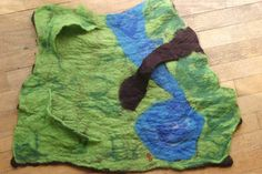 wet felted playmat - with great step-by-step photos of the process - from Imagination in Parenting