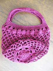 This is the first market bag I made that was inspired by a flower. The pattern begins by creating the flower at the bottom, working up to the mesh, and finishing with the strap. Petals (or leaves!) around the top edge of the mesh make the transition from the mesh to the strap.