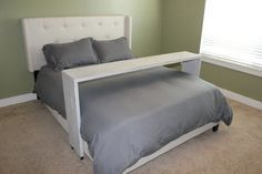 Roll-Over Bed Table - solid wood with wheels. Makes an excellent laptop desk. Great for watching movies.