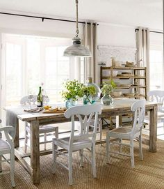 The owners of this DIY North Carolina home dreamed a farmhouse table for their dining room. The husband only bought screws and glue to construct this table. He found free building plans online at ana-white.com, and scored the lumber from a landowner, just by asking.   - CountryLiving.com