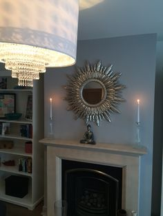 Silver cimiero round mirror featured in living room on Cowboy Builders & Bodge Jobs Tv Show.