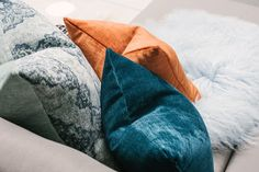 Add a splash of colour to any room with fun, comfy pillows. Find this and more decor inspo at CF Interiors.