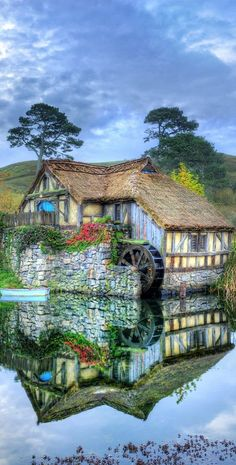 Discover the real Middle-earth on the most picturesque private farmland near Matamata in the North Island of New Zealand, where you can visit the Hobbiton Movie Tolkien, New Zealand Landscape, Water Mill, Le Moulin, The Hobbit, Hobbit Land, Dream Vacations, Beautiful Landscapes, Places To See