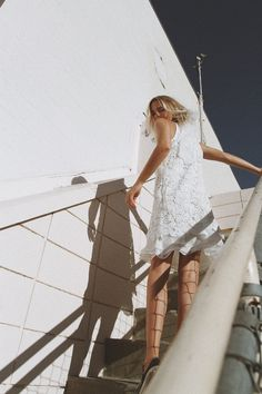 White dress / chucks. Via Mija
