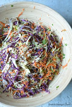 Clean eating is easy! This salad has quinoa, tons o' vegs, and sesame ginger vinaigrette. GF and vegetarian, add chicken or pork. Asian Quinoa Slaw Salad on thekitchengirl.com
