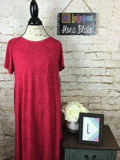 This Carly ended up being more pink than red. It looks great with gray or navy leggings!