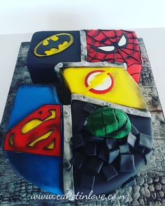 "A massive ""J"" chocolate cake filled with chocolate ganache. Super hero Decorations pettinice and chocit."