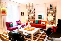 "Designer Jonathan Adler's ""maximalist"" approach to design is apparent upon entering the approximately 2,500-square-foot New York duplex he shares with his husband, Barney's New York creative director, Simon Doonan. The den, shown here"