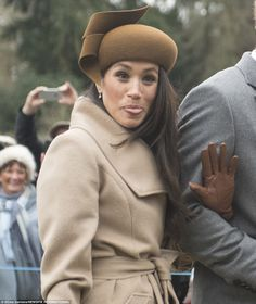 In a cheeky moment, Meghan is pictured sticking her tongue out while waving at the assembled crowds outside the church