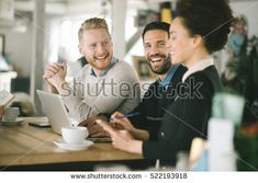 Business colleagues working together in cafe