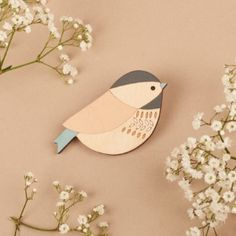 Anna Wiscombe Coaltit Brooch: A beautifully stylised coaltit brooch pin,lovingly handcrafted from birch plywood and finished with delicate handpainted detail. Design by Anna Wiscombe. This elegantrange makes excellent gifts for all ages and occasions.