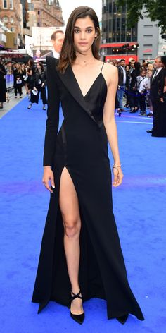 Pauline Hoarau also brought her fashion A game to the London Valerian red (blue) carpet. The model wore a slip dress/tuxedo jacket hybrid complete with a sky-high slit. Simple gold jewelry and a pair of strappy black satin pumps finished the glamorous look.