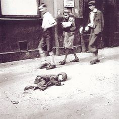 September 19, 1941. A child dying in the streets of the Warsaw Ghetto. In October 1940, the Germans began to concentrate Poland's population of over 3 million Jews into overcrowded ghettos. In the largest of these, the Warsaw Ghetto, thousands of Jews died due to rampant disease and starvation, even before the Nazis began massive deportations from the ghetto to the Treblinka extermination camp.