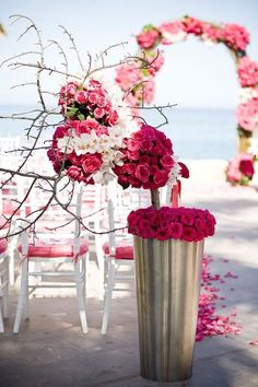 White or colorful flowers are both beautiful details to have at your beach wedding. Check out these beach wedding ceremony ideas from Elena Damy inside!