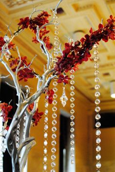 """Silver branches with crystal garland. Decorate with appropriate flowers? Could do this """"sun"""" or """"moon"""" style."""