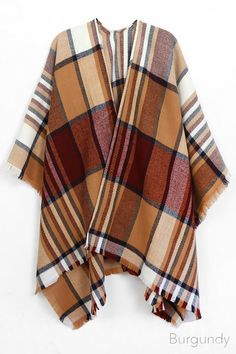 """This beautiful scarf Kimono Wrap is unlike other scarves! It has a place to fit perfectly on your shoulders!    ONE SIZE    L-31.5"""" W-47""""    Ships out mid October!! Free Shipping!! 