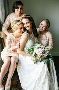 Adorable photo with a bride and her bridesmaids. Sweet and full of love.