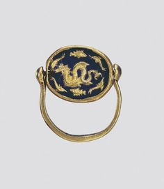 Ring with an Inset of Clear Blue Glass. A: Sea Monster Surrounded by Fishes and Dolphins. B: Dancing Figures. Date: Circa 350 bc. Place of finding: Pavlovsky Barrow. Archaeological site: Crimea, environs of Kerch. Material: gold and glass. | © 1998 - 2015 The State Hermitage Museum.