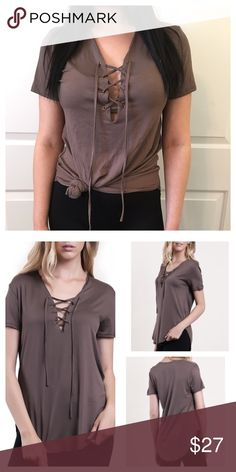 """Basic Mocha Eyelet Detailed Lace up SS T A Great Everyday Soft Basic  Eyelet Detailed Lace up Short Sleeve                   Mocha T.  Pair up with Jeans or Shorts. Soft Stretchy Fabric.   Modeling  Size: Small ~NWOT~Fit: Fitted in Bust Area & Semi Loose from waist down. Measurements Laying Flat: Armpit to Armpit 16.5"""" Length 25.5"""" Material: 95% Rayon 5% Spandex (Apx 1/2"""" inch difference between all sizes) Tops Tees - Short Sleeve"""