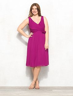 Love the style, not sure of the color, but would LOVE this is salmon or ORANGE!  db RSVP™ Plus Size Flower V-Neck Dress