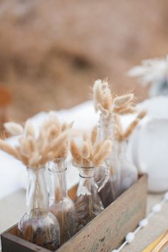 cute accents!! Wheat in glass bottles. Simple and rustic.