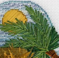 Open Fly Stitch with multiple values of greens, overdyed threads and touches of metallic make lovely airy palm fronds on blank canvas or on painted canvas.