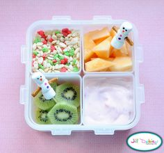 Bento Box:    And lastly, a little snowman bento for her morning nutrition break. I made 2 snowman picks using 3 mini marshmallows, pretzel sticks, food safe markers and a toothpick. I used these picks for her cantaloupe and kiwi. She also had a container of holiday rice krispies and a container of yogurt.