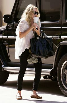 Ashley Olsen out in a breezy black and white look. #style #fashion #olsentwins