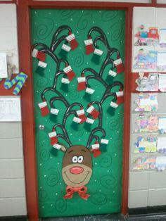 this is a cute christmas door down the hall from me at wmp each stocking has a name on it