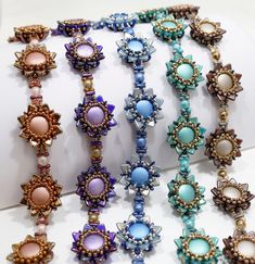 At the heart of Red Panda Beads is our Gallery of Color Suggestions. Here, you will find the latest additions of beautiful colorways for all the different types of handcrafted jewelry you can make. See all the newest color suggestions and patterns here. Woven Bracelets, Seed Bead Bracelets, Seed Beads, Bead Jewellery, Beaded Jewelry, Beaded Necklaces, Diy Jewelry Inspiration, How To Make Beads, Beaded Flowers