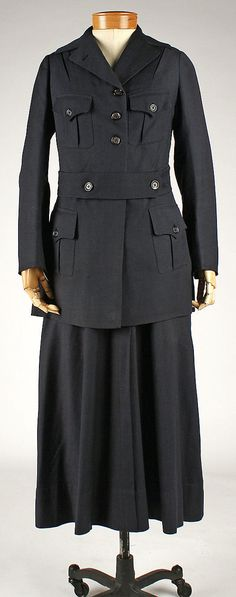 Barrel Shaped silhouettes were very common during this era. Women's wear from 1914-1918 was very bland and dark because it was thought of as being disrespectful to wear bright and fun colors when everyone was loosing people they loved. This is the perfect example of the square/v-neckline and sailors collars that were big in this time period. The loose belt at/above the natural waistline was found in fashion and in uniforms (like this one).